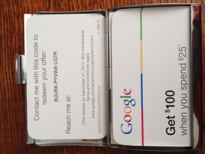 Google Engage direct mail package includes a business card holder and 20 custom cards for $100 Google AdWords Credit.